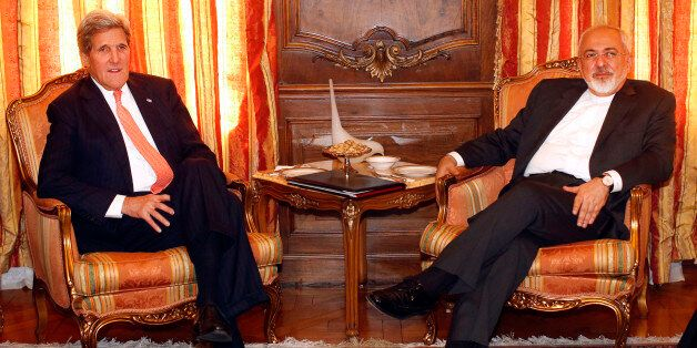 U.S. Secretary of State John Kerry, left, meets with Iran's Foreign Minister Mohammad Javad Zarif, Monday, April 27, 2015, in