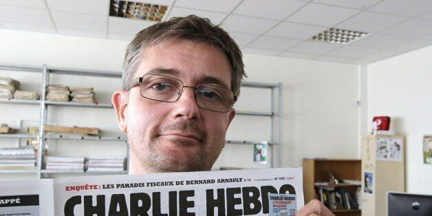 FILE - In this Sept.19, 2012 file photo, Stephane Charbonnier also known as Charb , the publishing director of the satyric we