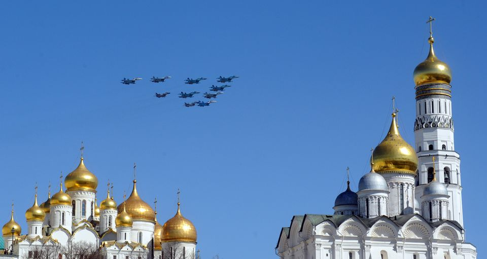 Russian fighter jets fire fly over the Kremlin cathedrals during a rehearsal of the Victory Day parade in Moscow on May 7, 20