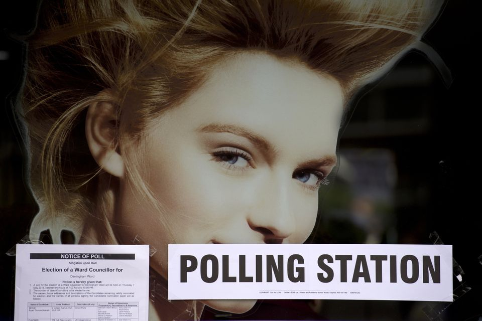 A sign directs voters to the Ush Hair hairdressing salon which is being used as a polling station in Hull, Northern England o