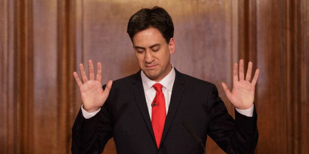 Britain's Labour Party leader Ed Miliband holds up his hands as he delivers his resignation at a press conference in Westmins