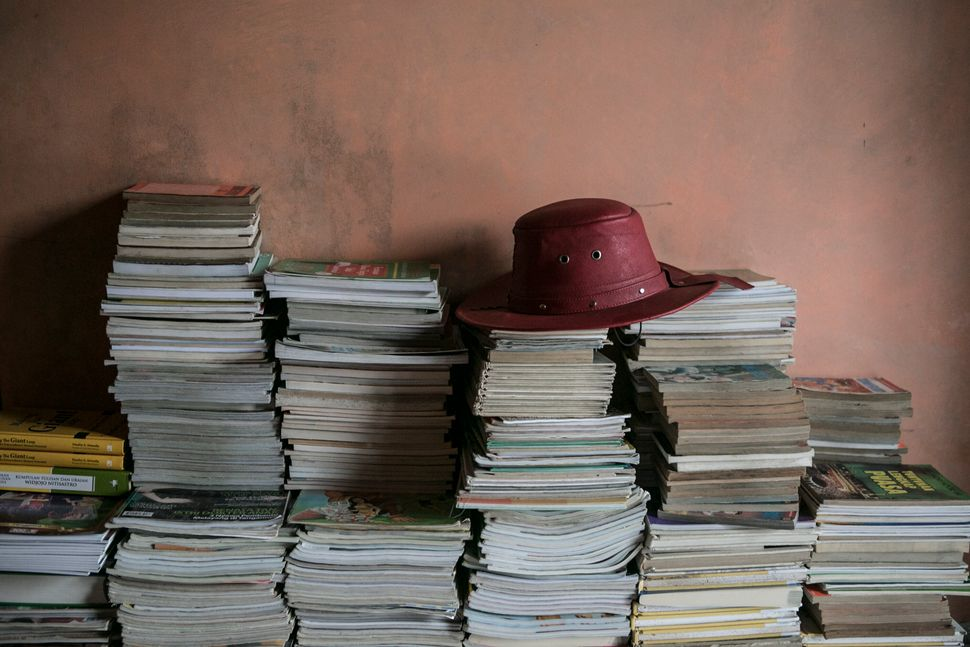 Ridwan Sururi's hat and books from the mobile library, May 5, 2015.