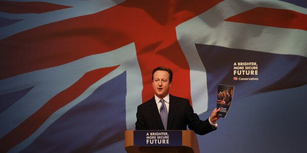 Britain's  Prime Minister David Cameron gestures as he unveils the Conservative party manifesto, in Swindon, England, Tuesday