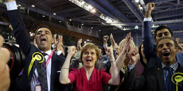 First Minister of Scotland and Scottish National Party leader Nicola Sturgeon, center, celebrates with the results for her pa