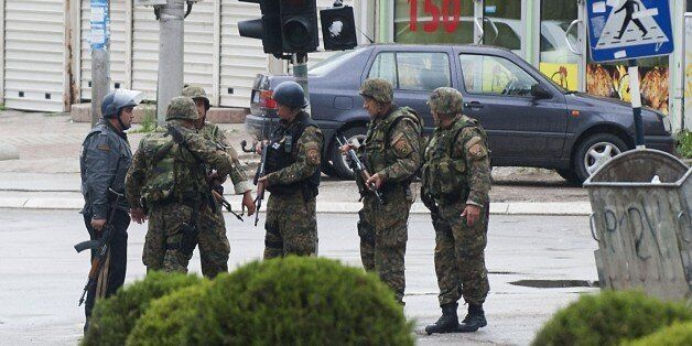 Police officers patrol in the streets of Kumanovo after armed incidents near the Kosovo border left four policemen injured on