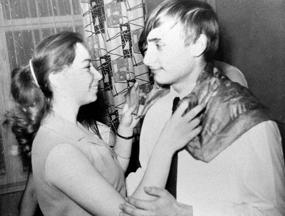 Vladimir Putin, right, dances with his classmate Elena during a party in St. Petersburg, Russia, 1970.