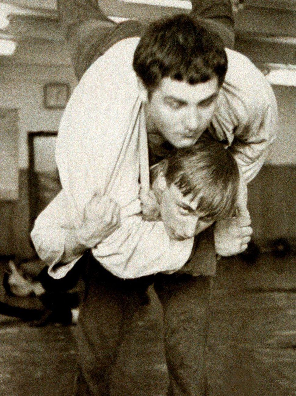 Vladimir Putin, bottom, wrestles with a classmate at the St. Petersburg Sportschool in 1971.