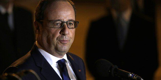 French President Francois Hollande speaks to reporters on the tarmac of Jose Marti Airport in Havana, Cuba, Sunday, May 10, 2
