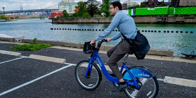 Alex Engel, with New York City Department of Transportation, rides a Bike Share bicycle during a demonstration of the program