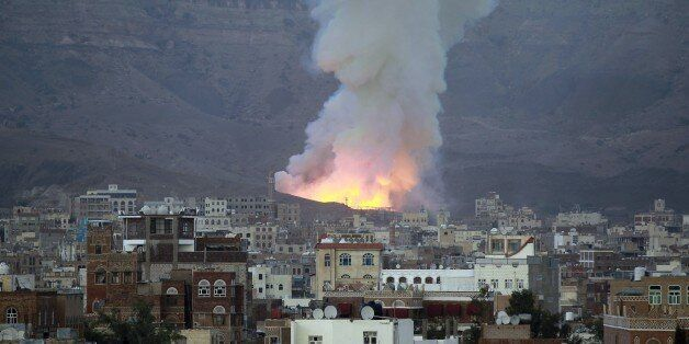 Smoke billows following an air-strike by Saudi-led coalition on May 11, 2015, in the capital Sanaa. The raid targeted an arms