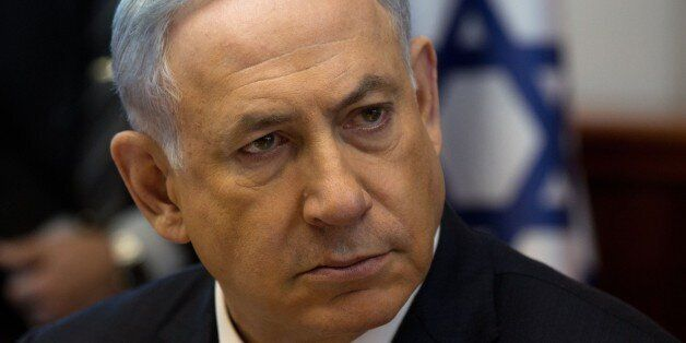 Israeli Prime Minister Benjamin Netanyahu looks on during the weekly cabinet meeting in his Jerusalem office, on April 19, 20