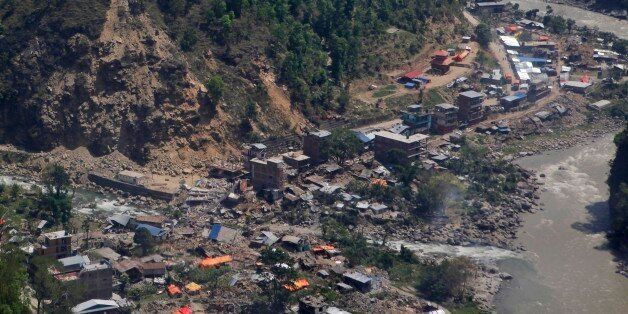 Damaged houses are seen from a helicopter at Charikot, Nepal, Thursday, May 14, 2015. Nepal has been overwhelmed by its secon