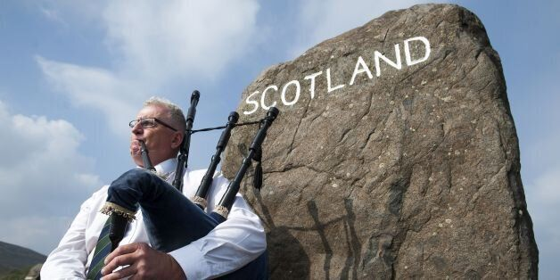 Piper Allan Smith plays the bagpipes for visitors near the town of Selkirk on the border between England and Scotland on Sept