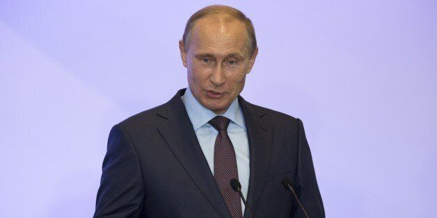 Russian President Vladimir Putin addresses members of Russian State duma fractions during a meeting in...