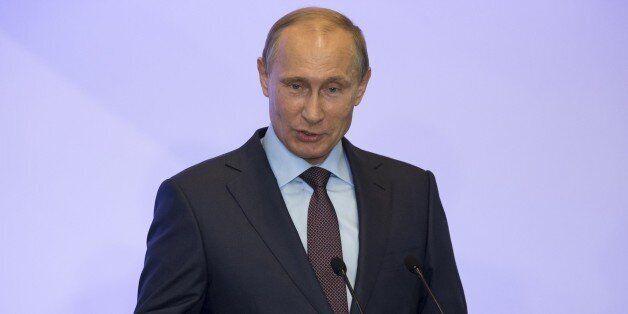 Russian President Vladimir Putin addresses members of Russian State duma fractions during a meeting in Mria sanatorium near Y