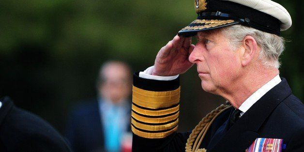 Britain's Prince Charles of Wales stays in attention during a memorial service marking the 100th anniversary of the start of