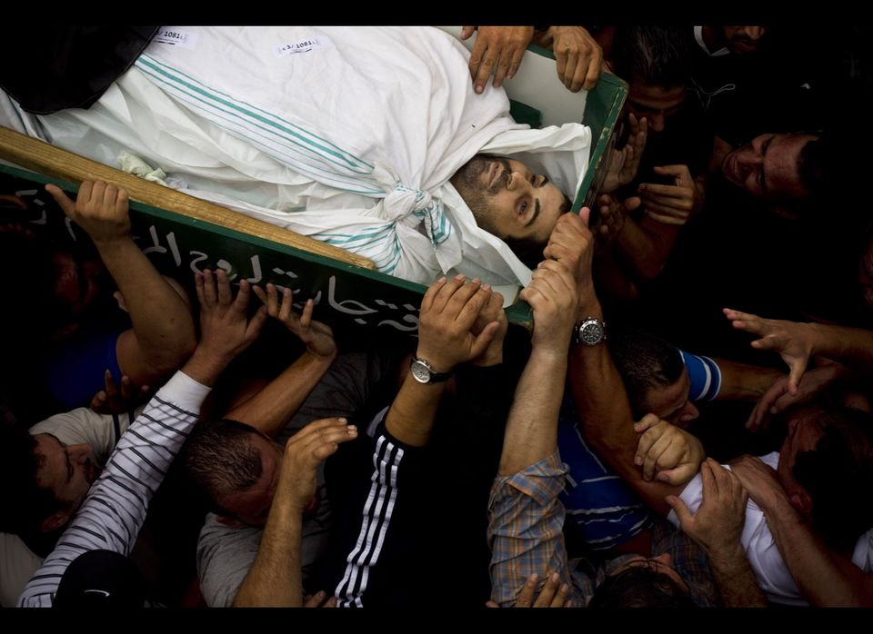 Palestinian mourners carry the coffin of Sami Sirhan during his funeral in the east Jerusalem neighborhood of Silwan Wednesda