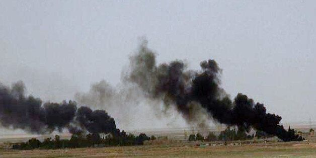 This picture released on Wednesday, May 20, 2015 on the website of Islamic State militants, shows black columns of smoke rising through the air during a battle between Islamic State militants and the Syrian government forces on a road between Homs and Palmyra, Syria. Islamic State militants overran the famed archaeological site at Palmyra early on Thursday, just hours after seizing the central Syrian town, activists and officials said, raising concerns the extremists might destroy some of the priceless ruins as they have done in neighboring Iraq. (The website of Islamic State militants via AP)