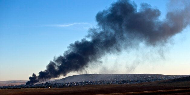 Smoke rises from an Islamic State position in eastern Kobani, after an airstrike by the US led coalition, seen from a hilltop