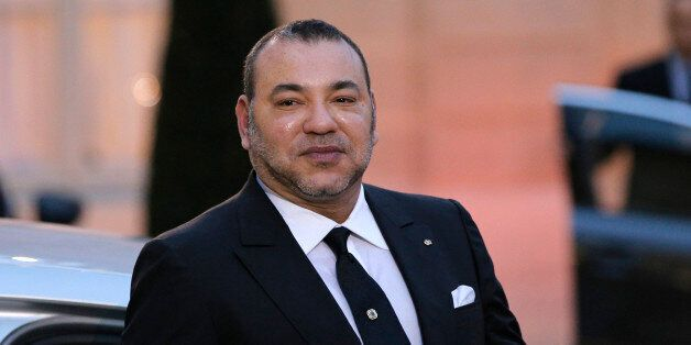 Morocco's King Mohammed VI poses as he leaves after a meeting with France's President Francois Hollande at the Elysee Palace,