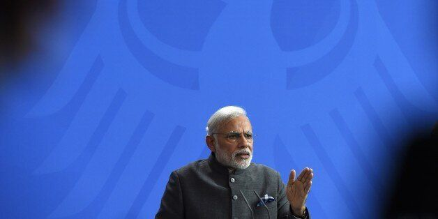 Indian Prime Minister Narendra Modi gestures during a press conference after talks with the German Chancellor in Berlin on Ap