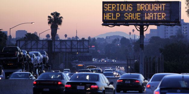 Morning traffic makes it's way toward downtown Los Angeles along the Hollywood Freeway past an electronic sign warning of sev