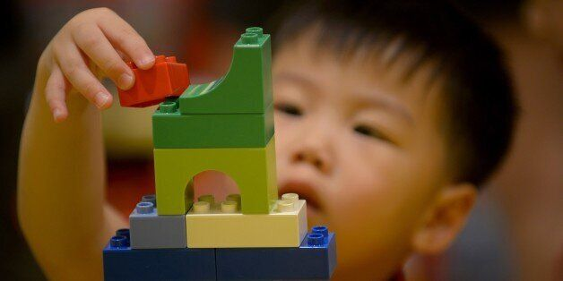 A child plays with Lego blocks during the opening of the brand's first certified store in Manila on May 12, 2015. Lego, the w