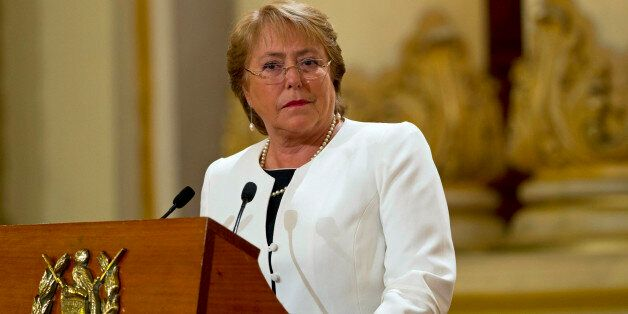 FILE - In this Friday, Jan. 30, 2015, file photo, Chile's President Michelle Bachelet listens to Guatemala's President Otto P