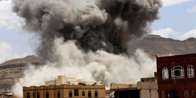 Smoke rises after a Saudi-led airstrike targeted a military base in Sanaa, Yemen, Sunday, May 24, 2015. Fighting raged on in