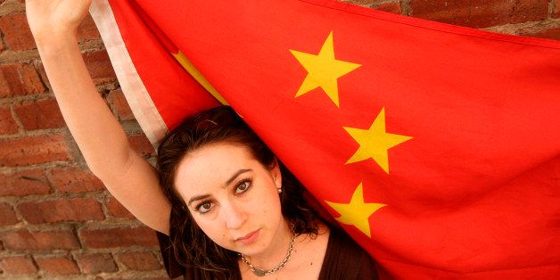 Melissa Sconyers, who studied abroad in China, is photographed with a Chinese flag in San Francisco, Monday, Aug. 11, 2008. C
