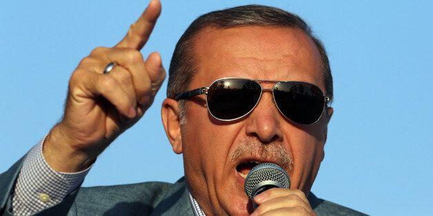 Turkey's President Recep Tayyip Erdogan addresses a rally in the courtyard of historical Haci Bayram Mosque in Ankara, Turkey