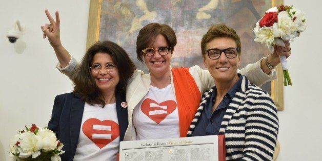 Same-sex couple Daniela Bellisario and Barbara Vecchieti pose with gay rights activist Imma Battaglia (R) after they register