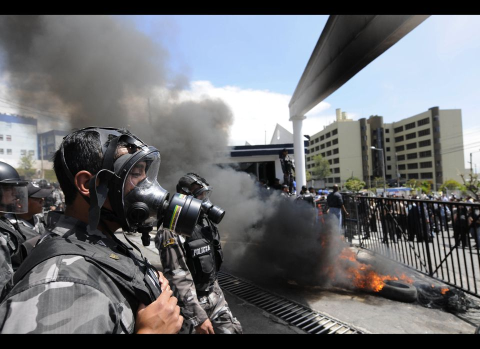 Protesting police burn tires at the entrance of their police base in Quito, Ecuador, Thursday Sept. 30, 2010.  The government