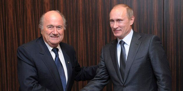 FILE - Russian Prime Minister Vladimir Putin, right, shakes hands with FIFA President Joseph Blatter after Russia was announc