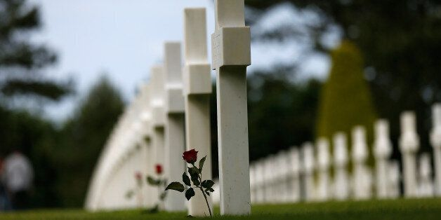 COLLEVILLE-SUR-MER, FRANCE - JUNE 03: A red rose is laid at the headstone of an American soldier at the Normandy American Cem