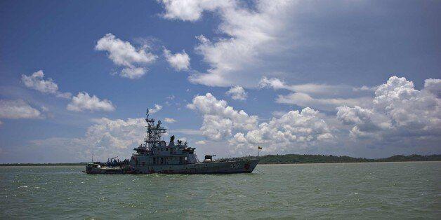 A Myanmar navy ship is anchored near Haigyi island, NgaPuTaw Township, Irrawaddy Division on May 30, 2015. More than 700 migr