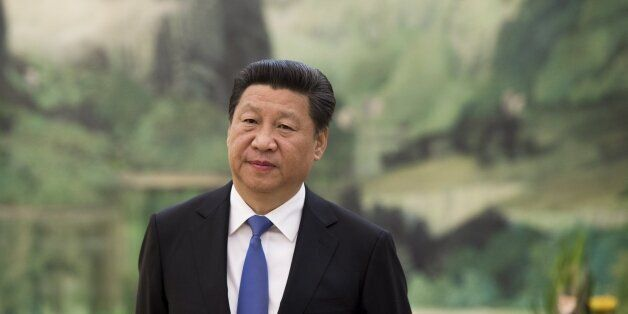 Chinese President Xi Jinping awaits the arrival of US Secretary of State John Kerry for a meeting at the Great Hall of the Pe