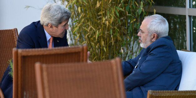 U.S. Secretary of State John Kerry, left, talks with Iranian Foreign Minister Mohammad Javad Zarif, in Geneva, Switzerland, S