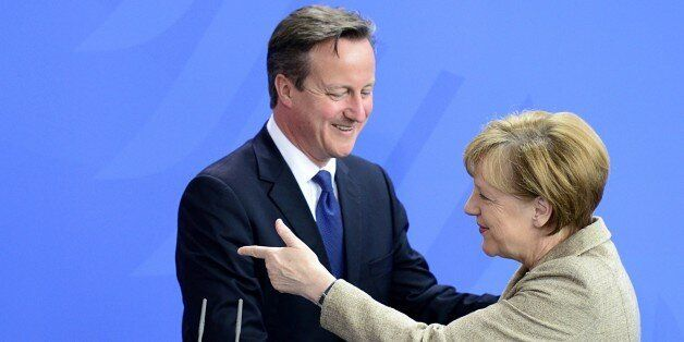 German Chancellor Angela Merkel (R) and British Prime Minister David Cameron shake hands at the end of their joint statement