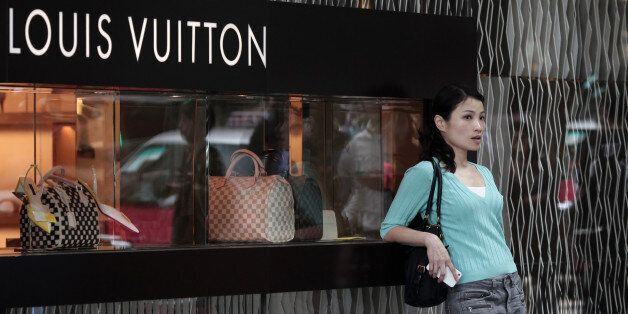 To go with Lifestyle-HongKong-China-luxury,FOCUS by Beh Lih Yi This picture taken on April 23, 2013 shows a Chinese woman le