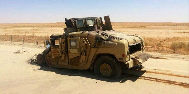 A destroyed Iraqi army humvee is left behind outside of the northern city of Mosul, Iraq, Wednesday, June 25, 2014, more than