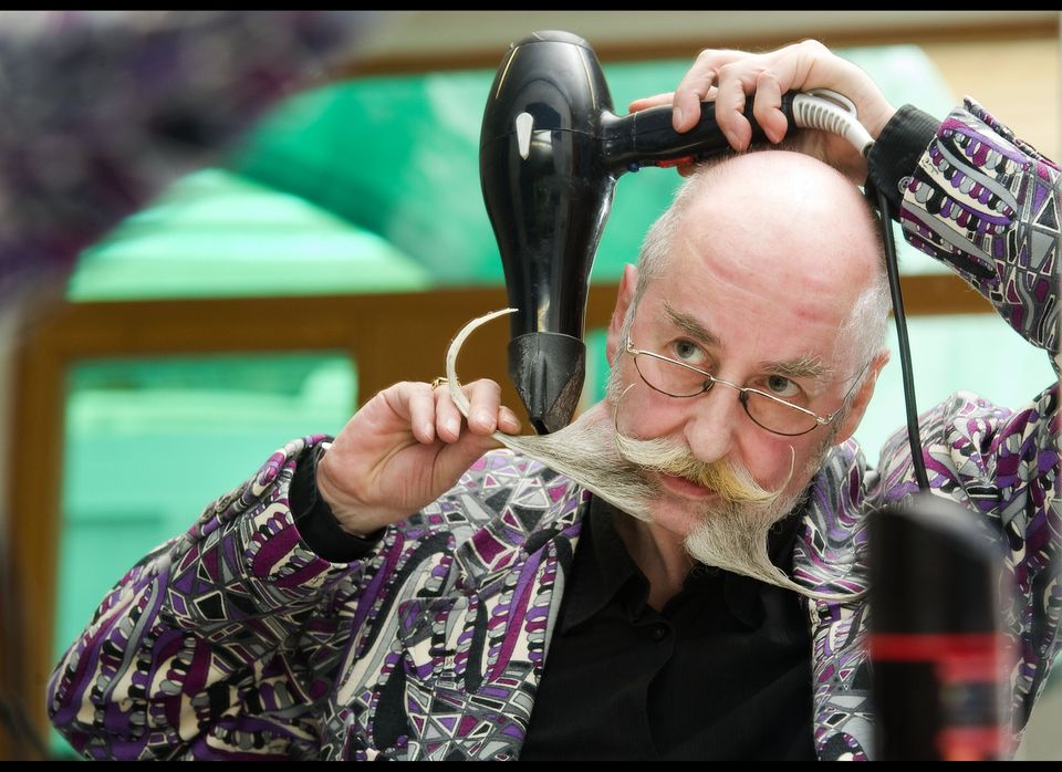 Germany's Stefan Bartl takes a blow dryer to his beard.
