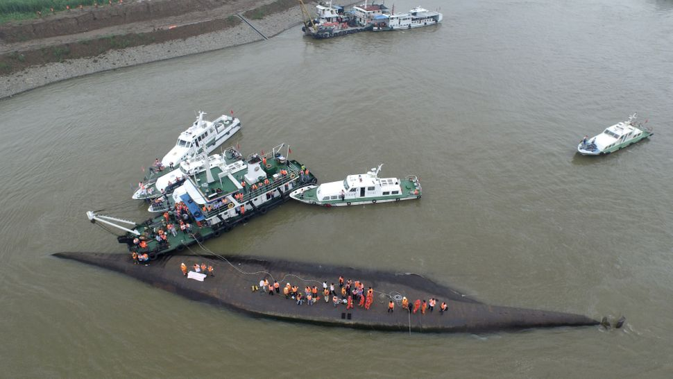 Rescuers search for survivors from the capsized ship Dongfangzhixing in the Yangtze River on June 2, 2015 in Nanjing, China.