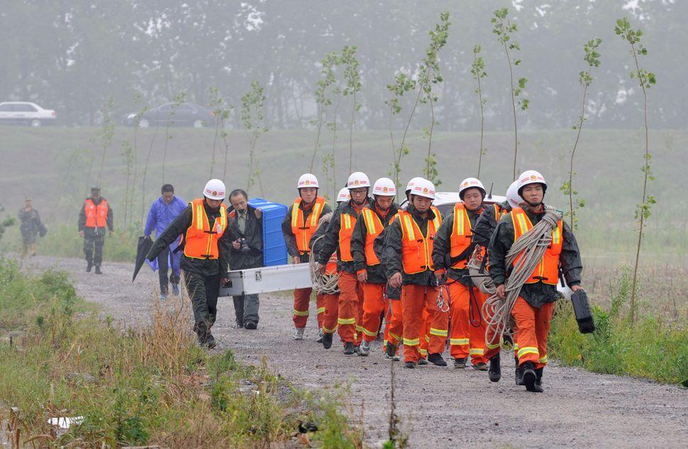 Rescuers prepare to search for survivors.