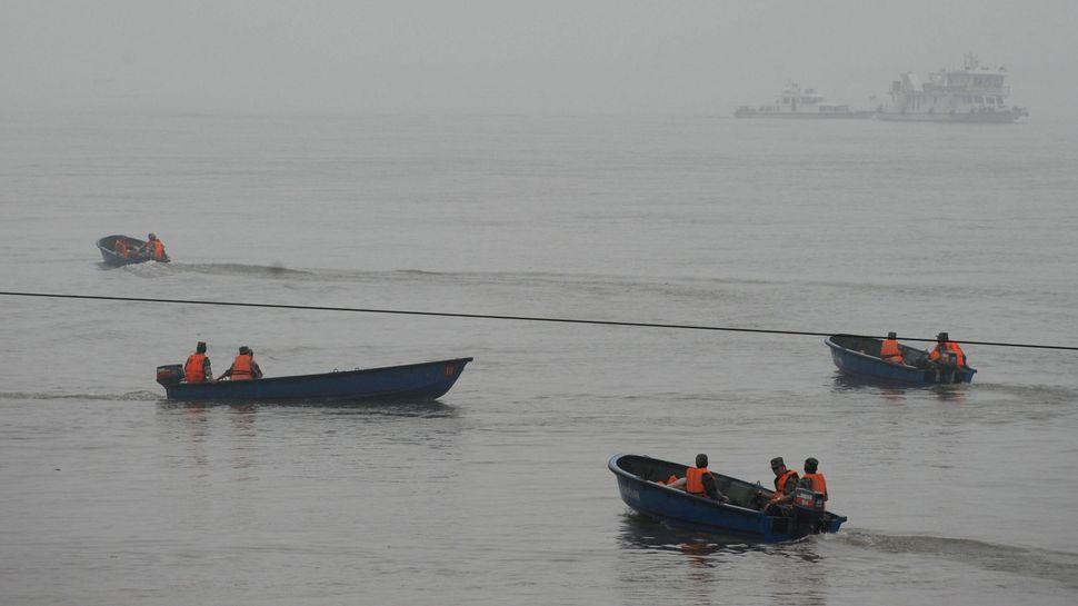 Rescue teams search for survivors.