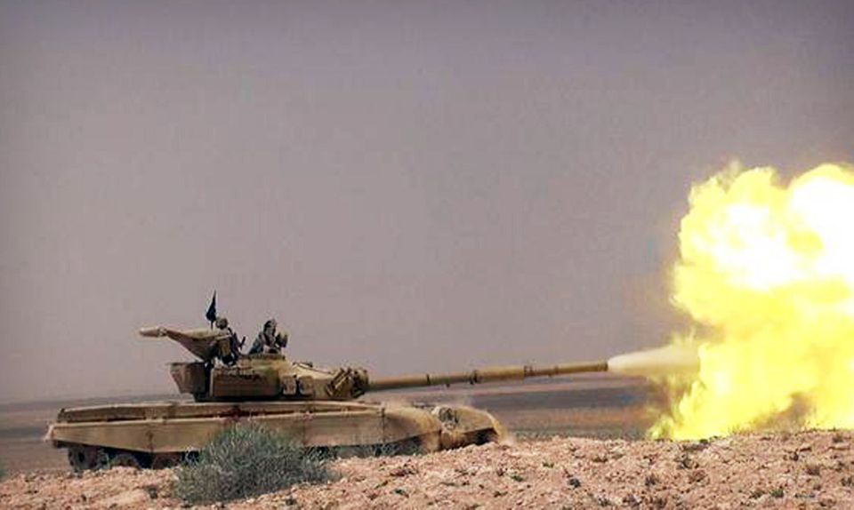 This picture released on Wednesday, May 20, 2015 by the website of Islamic State militants, shows a tank with Islamic State g