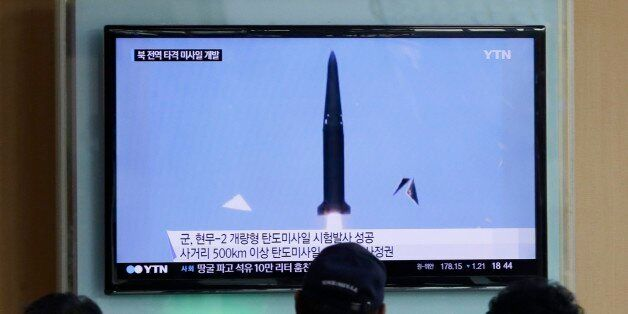 People watch a TV news program showing  South Korea's missile test at Seoul Railway Station in Seoul, South Korea, Wednesday,