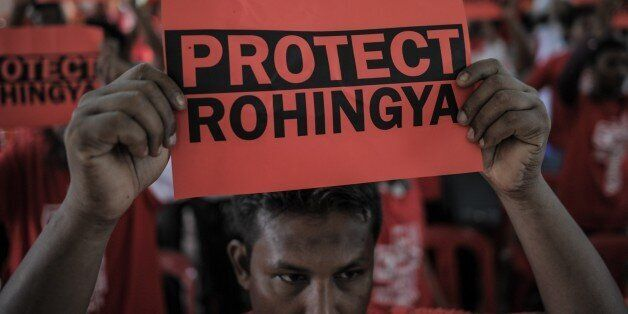 Ethnic Rohingya refugees from Myanmar residing in Malaysia hold placards during a rally over the current Rohingya crisis at a
