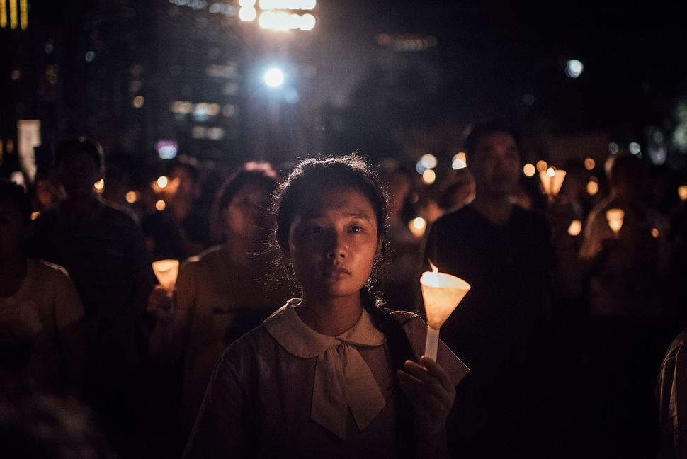 Participants take part at the candlelight vigil as they hold candles at Victoria Park on June 4, 2015 in Causeway Bay, Hong K