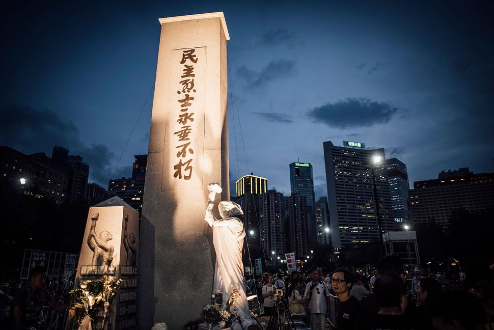 Participants holds candles and placards at Victoria Park on June 4, 2015 in Causeway Bay, Hong Kong.